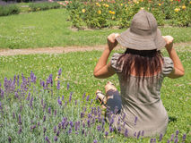 Woman on lavender. Fine woman sitting on the green grass Stock Photos