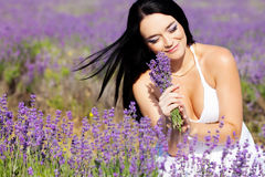 Woman with lavender flowers Stock Photos