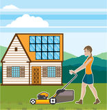 Woman with lawnmower at her house Royalty Free Stock Photography