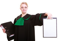 Woman lawyer attorney in classic polish gown holds clipboard blank sign Royalty Free Stock Images