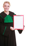 Woman lawyer attorney in classic polish gown holds clipboard blank sign Royalty Free Stock Photo