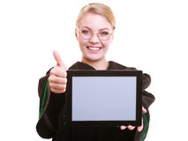 Woman lawyer attorney in classic polish gown holds tablet blank Stock Photos