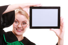 Woman lawyer attorney in classic polish gown holds tablet blank Royalty Free Stock Image