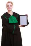 Woman lawyer attorney in classic polish gown holds tablet blank Royalty Free Stock Photography