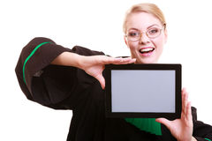 Woman lawyer attorney in classic polish gown holds tablet blank Royalty Free Stock Photo