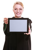 Woman lawyer attorney in classic polish gown holds tablet blank Royalty Free Stock Photos