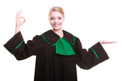 Woman lawyer attorney in classic polish gown making ok hand sign Royalty Free Stock Image