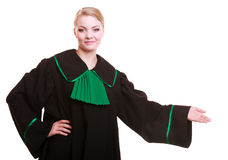 Woman lawyer attorney in classic polish gown in welcome gesture Stock Image