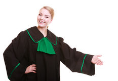 Woman lawyer attorney in classic polish gown in welcome gesture Stock Photography