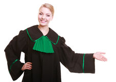 Woman lawyer attorney in classic polish gown in welcome gesture Royalty Free Stock Photography