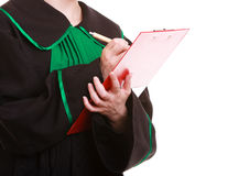 Woman lawyer attorney in classic polish gown writing on clipboard Royalty Free Stock Images