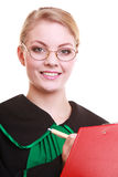 Woman lawyer attorney in classic polish gown writing on clipboard Royalty Free Stock Photography