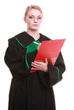 Woman lawyer attorney in classic polish gown writing on clipboard Royalty Free Stock Image