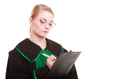 Woman lawyer attorney in classic polish gown writing on clipboard Royalty Free Stock Photos