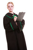 Woman lawyer attorney in classic polish gown writing on clipboard Stock Photos