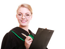 Woman lawyer attorney in classic polish gown writing on clipboard Stock Photo