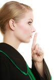 Woman lawyer attorney finger on lips. Royalty Free Stock Photography