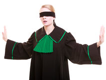 Woman lawyer attorney in polish black green gown with blindfold Stock Photo