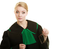 Woman lawyer attorney wearing black green gown Royalty Free Stock Photo