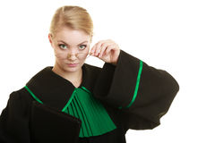 Woman lawyer attorney wearing black green gown Stock Photography