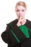 Woman lawyer attorney wearing classic polish gown asking for silence Stock Images