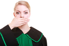 Woman lawyer attorney wearing classic polish gown covering mouth Stock Photography