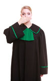 Woman lawyer attorney wearing classic polish gown covering mouth Stock Image
