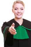 Woman lawyer attorney wearing classic polish gown giving hand for handshake Stock Photos