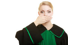 Woman lawyer barrister covering mouth with hand. Stock Image