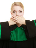 Woman lawyer barrister covering mouth with hands. Confidential information. Law court or justice concept. Woman lawyer barrister wearing classic polish black stock image