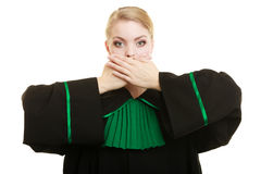 Woman lawyer barrister covering mouth with hands. Royalty Free Stock Images
