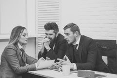Woman lawyer explain terms of transaction. Business negotiations concept. Business partners, businessmen at meeting. Office background. Business negotiations Royalty Free Stock Images