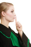 Woman lawyer finger on lips as quiet sign Royalty Free Stock Image
