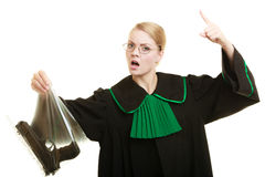 Woman lawyer with gun bag marked evidence for crime. Law court or justice concept. Woman lawyer attorney wearing classic polish black green gown with weapon gun stock image