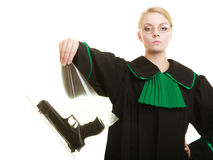 Woman lawyer with gun bag marked evidence for crime. Law court or justice concept. Woman lawyer attorney wearing classic polish black green gown with weapon gun royalty free stock photography