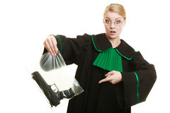 Woman lawyer with gun bag marked evidence for crime. Royalty Free Stock Photography