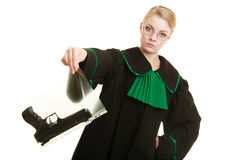 Woman lawyer with gun bag marked evidence for crime. Law court or justice concept. Woman lawyer attorney wearing classic polish black green gown with weapon gun stock photography