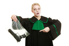 Woman lawyer with gun bag marked evidence for crime. Royalty Free Stock Image