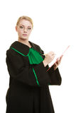 Woman lawyer holding clipboard writing Royalty Free Stock Photo