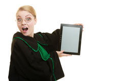 Woman lawyer holds tablet blank copy space. Woman lawyer attorney in classic polish gown holds tablet blank copy space. Technology Royalty Free Stock Photo