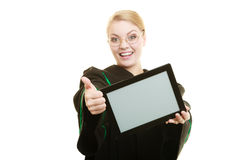 Woman lawyer holds tablet blank copy space. Woman lawyer attorney in classic polish gown holds tablet blank copy space. Technology Royalty Free Stock Photography