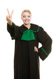 Woman lawyer making victory hand sign Stock Image