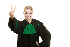 Woman lawyer making victory hand sign Stock Images