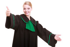 Woman lawyer in polish gown giving hand Royalty Free Stock Photo