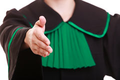 Woman lawyer in polish gown giving hand Stock Image