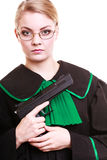 Woman lawyer in polish gown with gun. Crime. Royalty Free Stock Photos