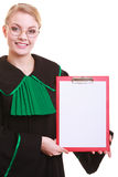 Woman lawyer polish gown holds clipboard blank Royalty Free Stock Images