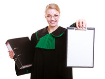Woman lawyer polish gown holds clipboard blank Stock Image