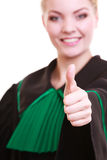 Woman lawyer in polish gown showing thumb up success Stock Photography