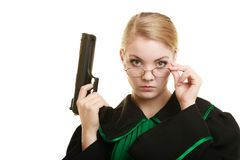 Woman lawyer with weapon gun. Crime. Law court or justice concept. Woman barrister lawyer wearing classic polish black green gown with weapon gun isolated on royalty free stock photos